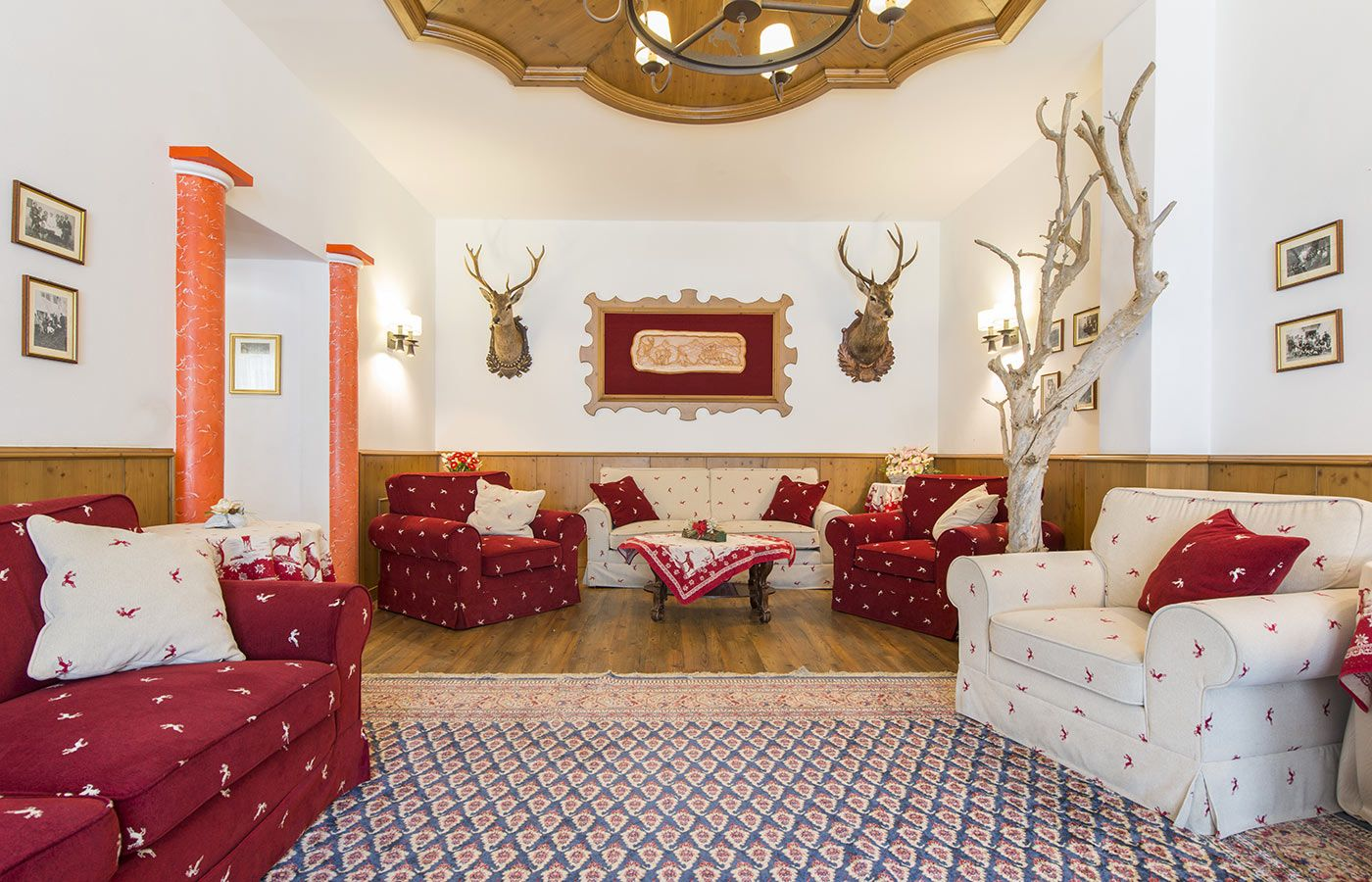 Traditional alpine furniture and decoration at Hotel Alpino