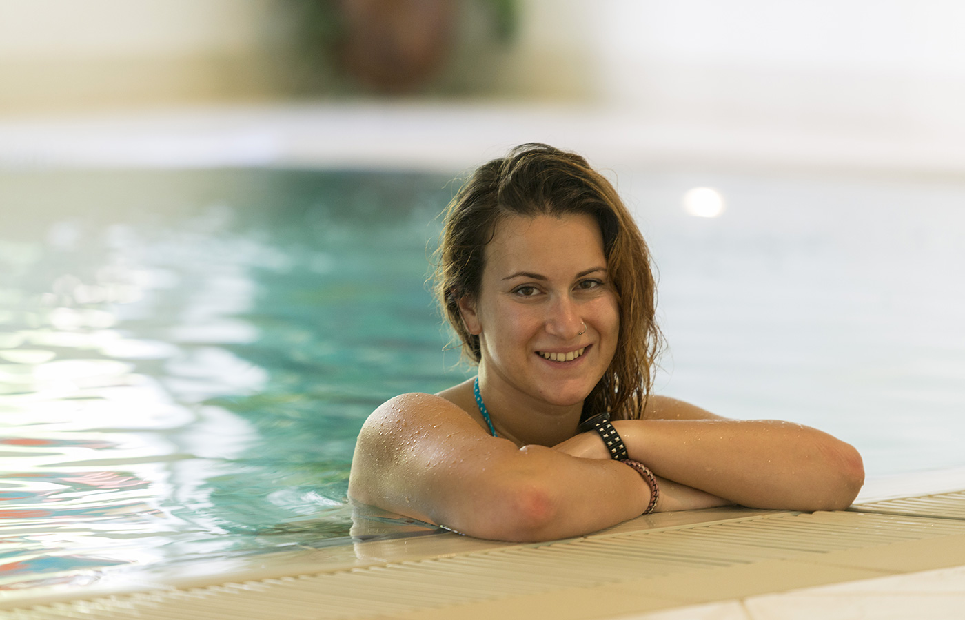 A girl in the pool of Hotel Alpino